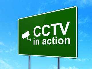 Safety concept: CCTV In action and Cctv Camera on road sign