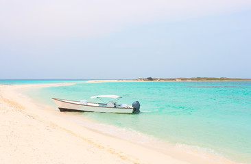 Boat at the tropical beach of Cayo de Agua island, Los Roques