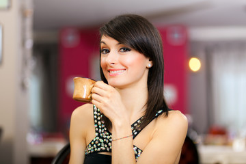 Woman drinking coffee at the restaurant