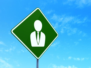 Finance concept: Business Man on road sign background
