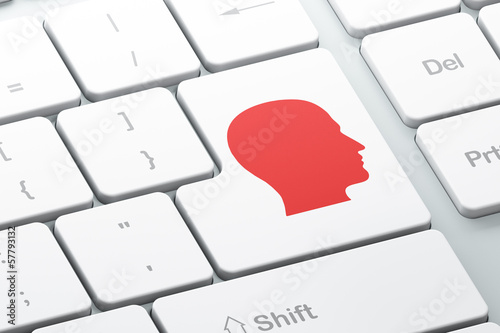 Education concept: Head on computer keyboard background