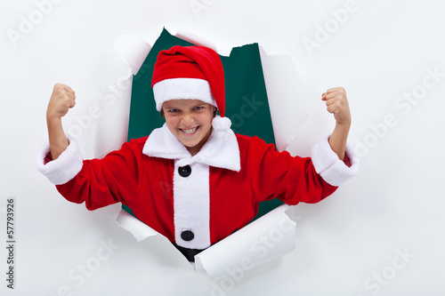 Powerful santa flexing his muscles