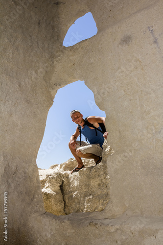 Tourist posing against the backdrop of the caves the cave city