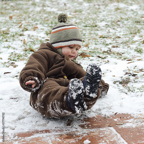 Child on icy slippery road