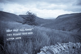 keep our forest tidy sign on mountain road in county Donegal poster