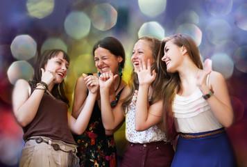 Teenage girls having fun at the party