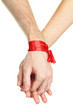 Mans and girls hands tied with ribbon isolated on white