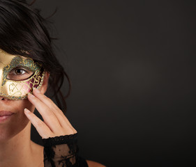 Atractive woman with venetian mask