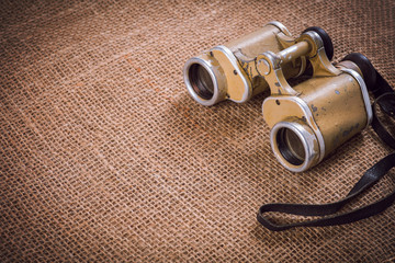 Old German military binoculars on canvas background