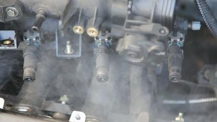 Automotive, car engine injectors splashing gasoline