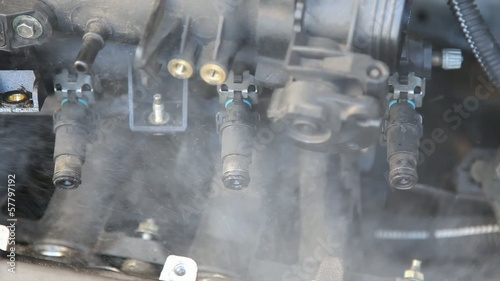Automotive, car engine injectors splashing gasoline