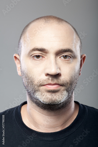 man portrait isolated on gray background