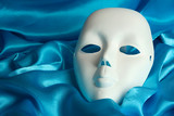 Mask on blue fabric background