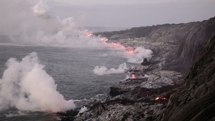 Ocean entry of lava flow with steam plumes, Kilauea, Hawaii