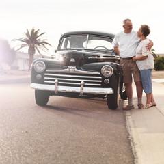 senior couple with vintage car