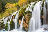 beautiful waterfall in colorful autumn