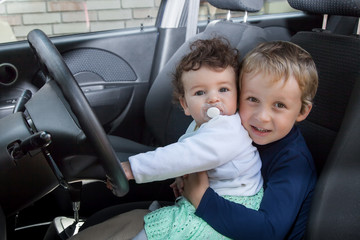 Children sit in the car