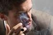 glamourous businessman smoking a cigar