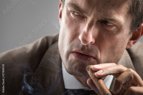 Severe gaze of elegant smoker