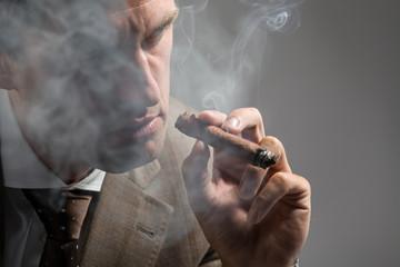 elegant man smoking a cigar