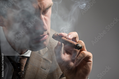 elegant man smoking a cigar