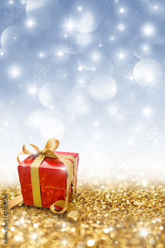 red gift on golden glitter