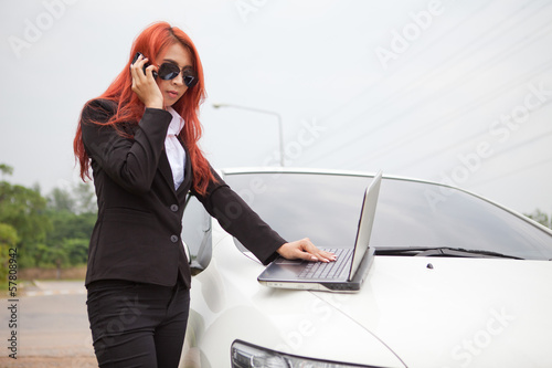 woman using laptop and mobile phone