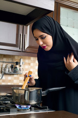 Arabian woman cooking in the kitchen