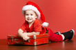 little cute boy with christmas suitcase