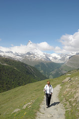 Walker on path above Sunnegga in Swiss alps