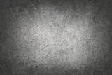 Dark gray rough concrete wall background photo background