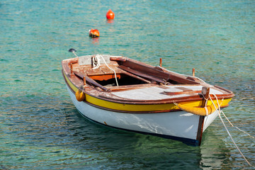 Wooden fishing boat floats moored in Adriatic sea