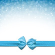Christmas blue background with gift bow.