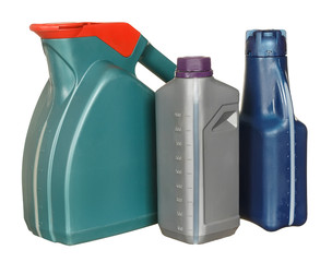 Plastic bottles from automobile oils isolated on a white