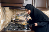 Arabian woman cooking stew in the kitchen