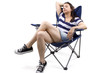 young female relaxing on a beach chair. white BG for composites