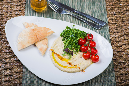 Plate with hummus dip and tapas