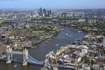 Aerial view River Thames between Tower Bridge and Canary Wharf