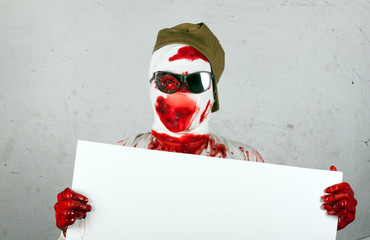 scary bloody zombie wearing a cap and glasses
