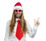 Silly happy hippie in a Santa hat pointing at copy-space on whit