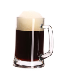 Tall big mug of brown beer with foam.