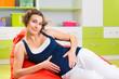 Pretty young pregnant woman
