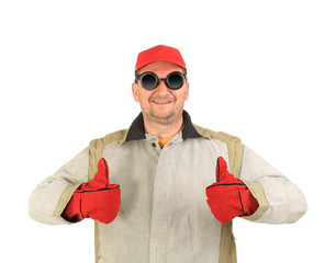 Smilling welder with thumbs up.