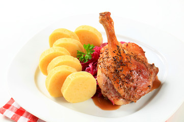 Roast duck with potato dumplings and red cabbage