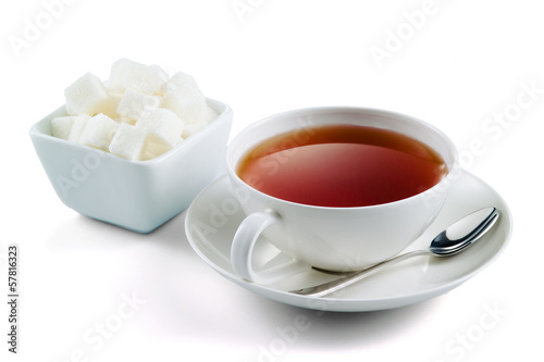 Blac tea with sugar cubes isolated on white background
