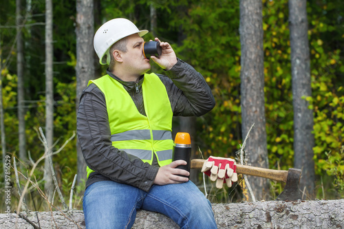 Lumberjack drinking tea from  plastic cup