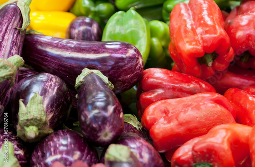 Eggplants and sweet pepper on a shop counter