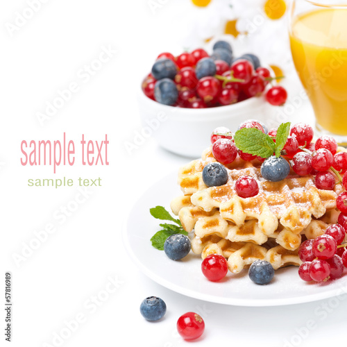 delicious breakfast with waffles, berries,  juice, isolated