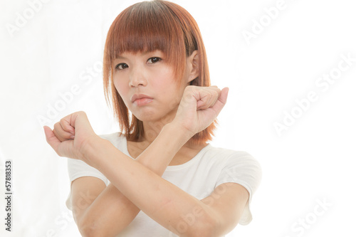 bright picture of young Asian woman making stop gesture