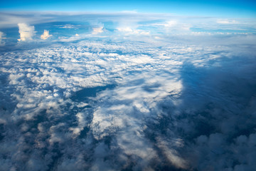 Looking down through the clouds to planet earth.